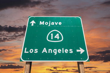 Mojave Desert Freeway Sign to Los Angeles with Sunset Sky