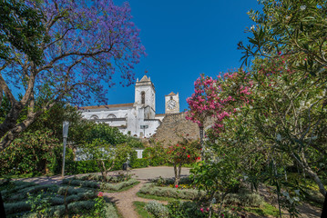 view from castle garden to the historic Church of Santa Maria do