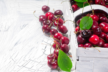 White basket with cherries