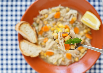 portuguese traditional chiken soup - top view with full spoon