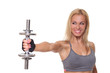 athletic young woman doing a fitness workout with dumbbells