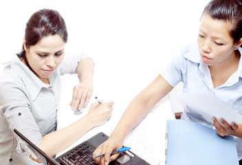 Two women working on laptop