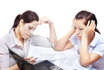 Two women frustrated with work