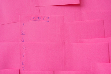 To do list, noted on pink note paper background