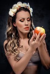 Beautiful seductive woman with apple