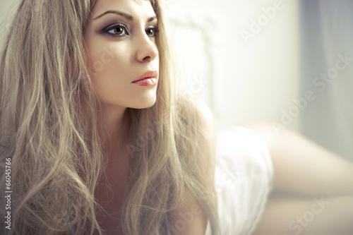 Sensual lady in classical interior