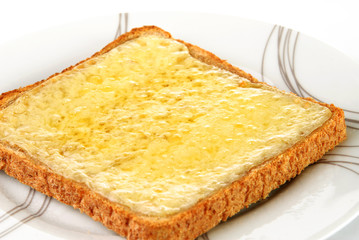 Grilled cheese on wholemeal toast served on a white plate
