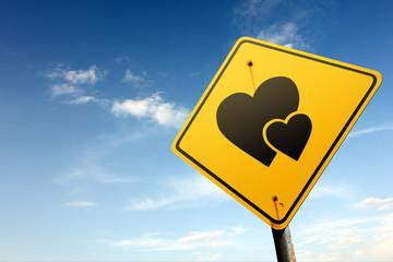 Love zone ahead. Yellow traffic sign.