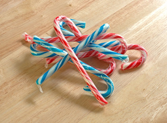 Candy canes on wood counter top