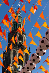 Orange flags and footballs during world soccer cup