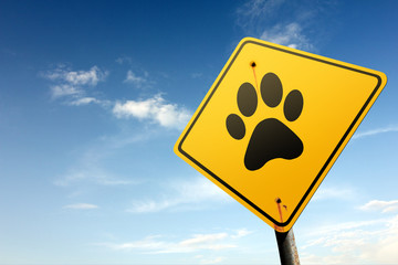 Animals ahead. Yellow traffic sign.