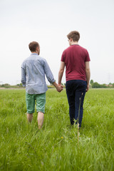 Homosexual Partners walking on a field