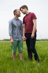 Gay Couple standing in a field