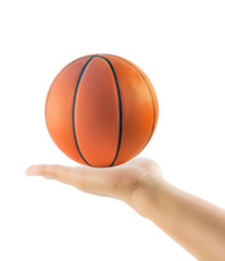 Hand holding basketball or basket ball isolated