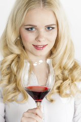 portrait of young woman with a glass of red wine