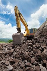 Excavator in the rock mine