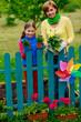 Gardening - familyworking in flowers garden