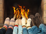 Fototapety Feet warming near the fireplace