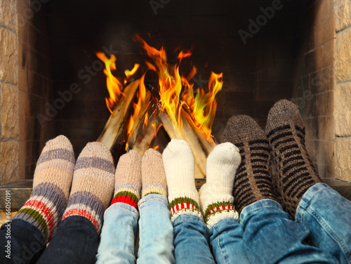 canvas print picture Feet warming near the fireplace