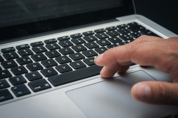 Detail of hands working on computer keyboard