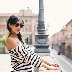 Smiling beautiful brunette woman portrait outdoors.