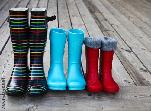 canvas print picture Three pairs of a colorful rain boots