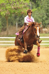Young lady is riding a horse