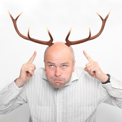 Funny picture of an husband with great antlers.