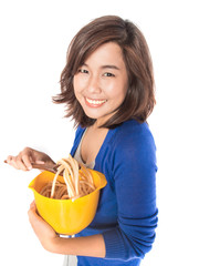 woman preparing pasta on white background.