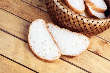 Two slices of bread near wicker breadbascked