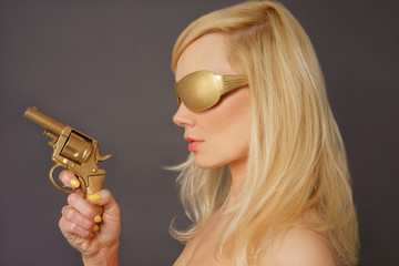 Blonde Lady Holding a Golden Gun