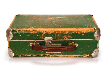 Old green shabby suitcase isolated on white