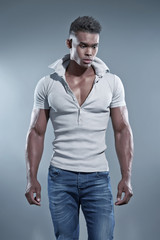 Black african man. Summer casual fashion. Studio shot against gr