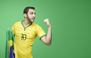 Brazilian soccer player celebrates on green background