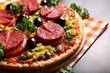 Pizza with Ham, Mushrooms, olives and parsley