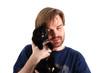 man and black cat