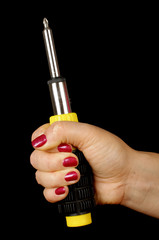 Female hand holding philips screwdriver