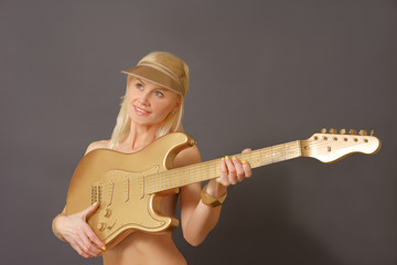 Blonde Model Playing Guitar