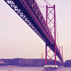 25 de Abril Bridge in Lisbon, Portugal, with a retro filter effe
