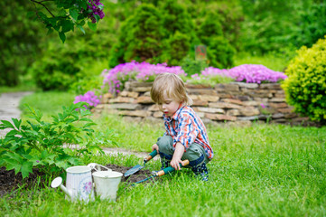 Cute kid playing in the beautiful garden