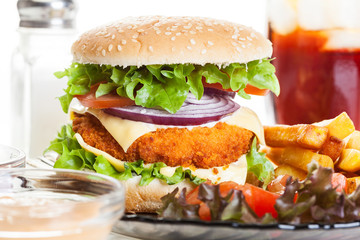 Chickenburger and glass of cola with ice