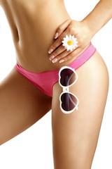 Girl showing her hips  wearing bikini and sunglasses