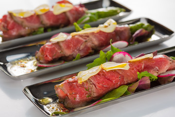 Beef carpaccio with salad leaves and vegetabales. tasty appetize