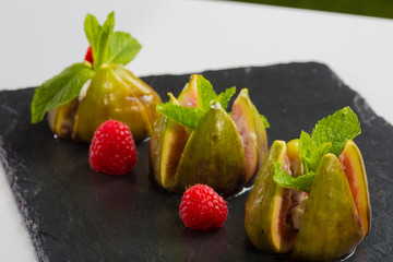 figs with raspberries, served as a dessert,