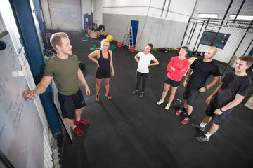 Personal trainer teaches his fitness workout team