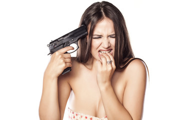 desperate girl holding a gun to her head