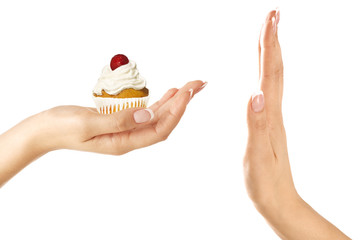 Closeup of Beautiful female hand give a rich cupcake