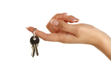 Beautiful female hand giving apartment keys