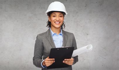 businesswoman in white helmet with clipboard