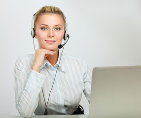 Portrait of beautiful business woman working at her desk with